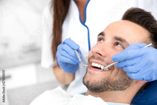 Man having teeth examined at dentists - 276205517