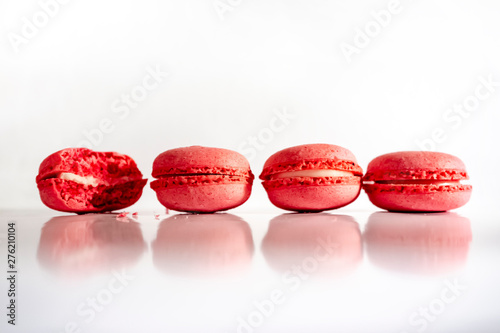 Foto auf AluDibond Macarons Delicious, sweet macaron cakes, coral color, on a white, glossy background. Traditional french confection.
