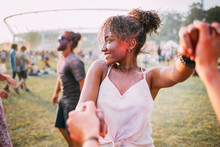 African American Young Woman With Friends Dancing At Summer Holi Festival