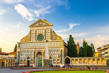Basilica Di Santa Maria Novella And Green Grass Lawn With Flowers On Piazza Santa Maria Novella Square In Historical Centre Of Florence City, Blue Sky White Clouds, Tuscany, Italy