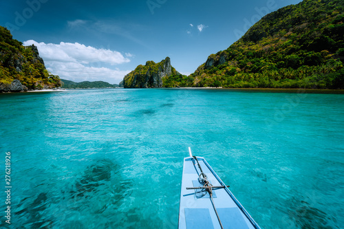 Wall Murals Green coral Boat trip to tropical islands El Nido, Palawan, Philippines. Steep green mountains and blue water lagoon. Discover exploring unique nature, journey to paradise