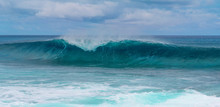 Beautiful Ocean Tube Wave Rolls Towards The Beach Of An Exotic Island In Pacific