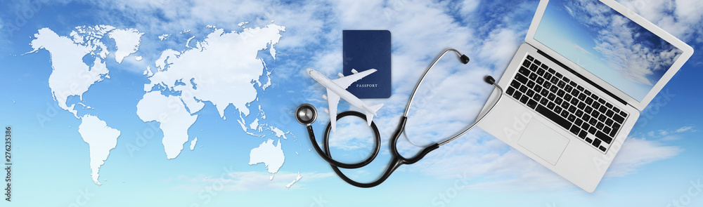 Fototapety, obrazy: international medical travel insurance concept, stethoscope, passport, laptop computer and airplane on sky background banner with global map