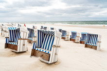 Beach - Chairs On The Island Sylt. Germany.  Summer Cloudy Weather.