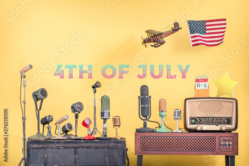 Retro microphones, wooden plane and USA flag, old radio