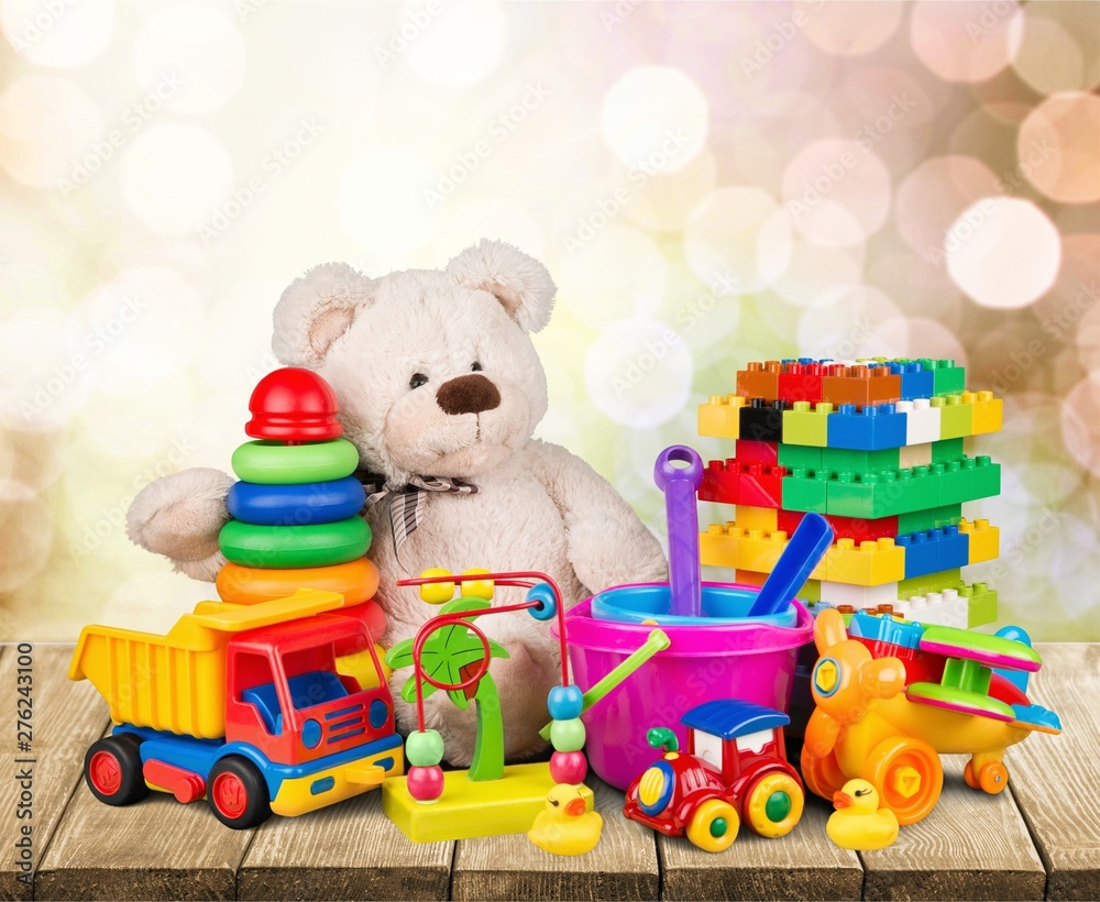 Fototapety, obrazy: Bear and collection colorful toys on wooden desk