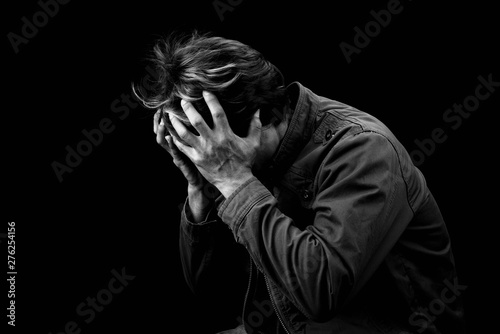 Photo Man sad cry or strain alone on black background black & white color