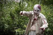 Male Zombie Holding Knife Stan...