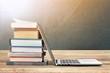 Leinwandbild Motiv Stack of books with laptop