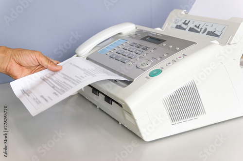 Obraz hand man are using a fax machine in the office - fototapety do salonu