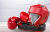 Pink boxing gloves on background