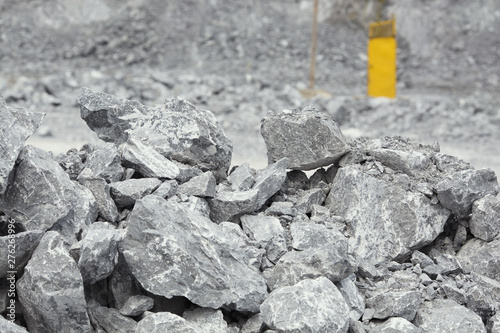 Large gray stones close-up in a quarry for limestone mining