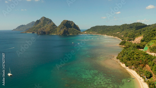 Poster Cote Aerial drone of tropical beach on background of mountains. Seascape with sea, sand, palm trees. Corong corong beach, El Nido, Palawan, Philippines. Summer and travel vacation concept