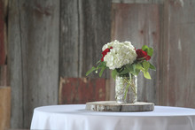 Flower Table Setting With Barnwood Background