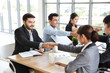 Multiethnic business people discussing company about new project in meeting room then they shaking their hands meaning of their job is success with smiling and happy faces