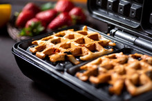 Waffle Pastry Baking On A Waffle Maker Close Up