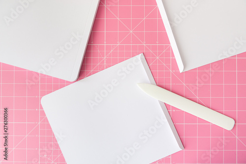 Fényképezés  Scoring tool and folded sheet of paper