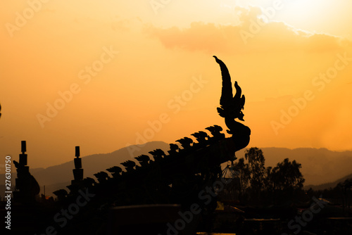 "silhouette of Naka head or serpent in buddhist, decorated car in procession of "" Fotobehang"