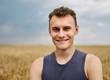 Young farmer in wheat field