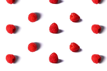 Pattern made of fresh raspberry isolated on white.