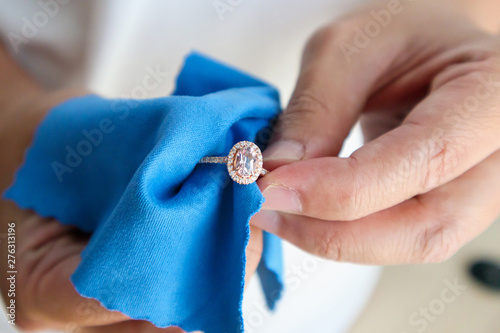 Canvas Prints Countryside Jeweller hand polishing and cleaning jewelry diamond ring with micro fiber fabric