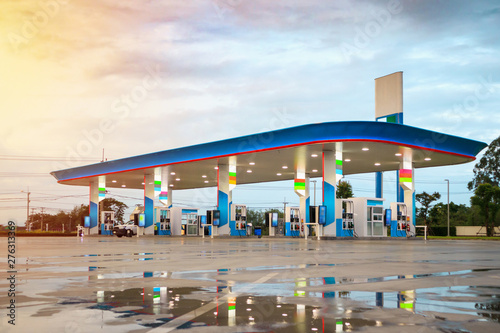 Gas fuel station with clouds and blue sky at sunset Fototapeta