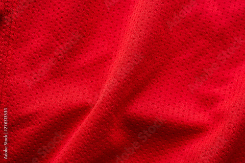 fototapeta na lodówkę Red fabric sport clothing football jersey with air mesh texture background