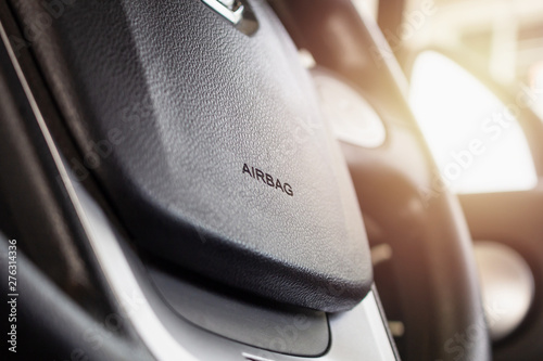 Photo Safety airbag sign on car steering wheel