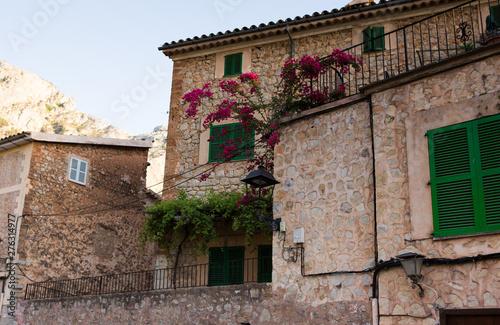 Fototapety, obrazy: Beautiful view of old mountain village Deia in Mallorca on a sunny day. Deia traditional stone village in Majorca Tramuntana mountain