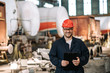 Leinwandbild Motiv Portrait of a smiling worker at metal manufacturing plant.
