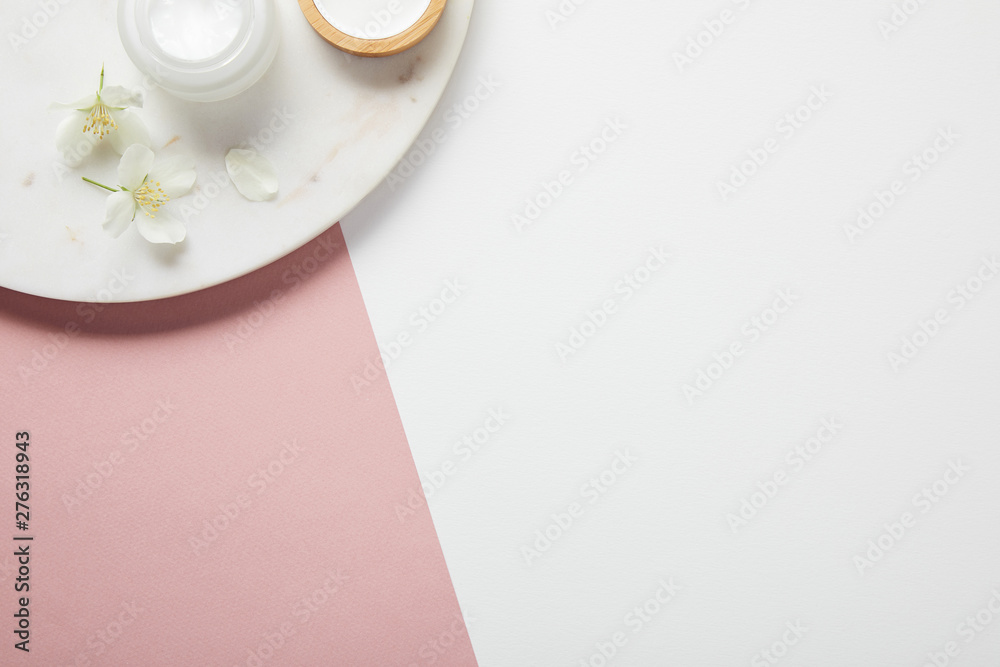 Fototapety, obrazy: top view of plate with cream and flowers on white pink surface
