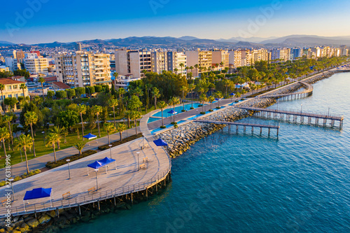 Obraz Limassol. Cyprus. The seafront of Limassol Molos day panorama. Beach promenade Limassol from the height. Mediterranean sea coastline. The beaches of Cyprus. Vacation in Cyprus seaside. - fototapety do salonu