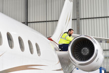 Aircraft Mechanic Inspects And...