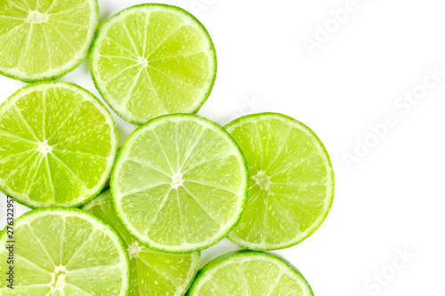 Vibrant lime slices, shot from above on a white background with copy space Wallpaper Mural