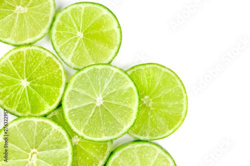Obraz na plátně  Vibrant lime slices, shot from above on a white background with copy space
