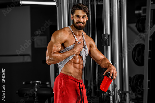 plakat Got Abs? Handsome Men In the Gym Showing, Checking Abdominal Muscles