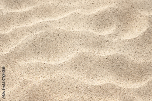 Background for design on the theme of the sea resort. Abstract natural pattern. Sand texture on the beach