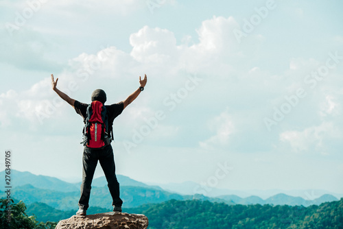Foto auf AluDibond Licht blau Hiker asian man happy feeling freedom good and strong weight victorious facing on the natural mountain. Travel Concept