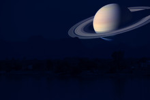 Saturn On Night Sky Back Silhouette Mountain And River