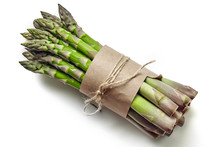 An Edible, Raw Stems Of Asparagus Isolated On White Background.