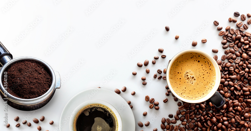 hot espresso and coffee bean on white table with soft-focus and over light in the background. top view