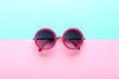 Leinwanddruck Bild - Modern sunglasses on colorful background