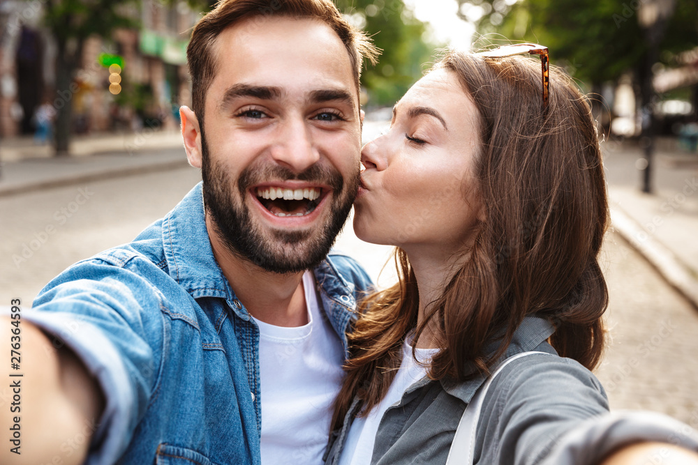 Fototapety, obrazy: Beautiful young couple in love standing outdoors