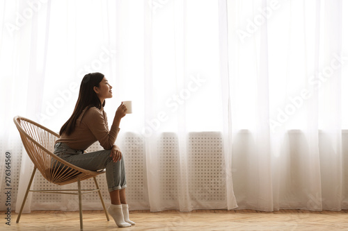 Fotografie, Obraz  Girl Sitting In Modern Chair, Enjoying Morning Coffee