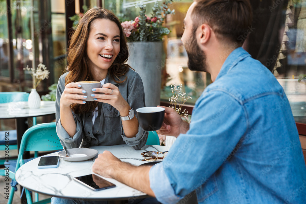 Fototapeta Attractive young couple in love having lunch