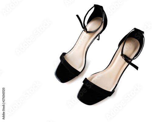 Obraz na płótnie black high-heeled sandals on a white background