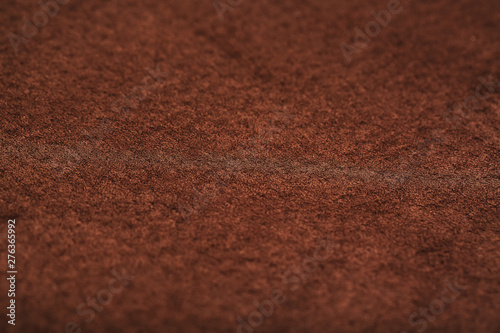 Brown velor textural background pattern. Gorgeous elastic velor fabric has a velvet pile, shine and texture.