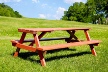 Wooden Picnic Bench On A Green...