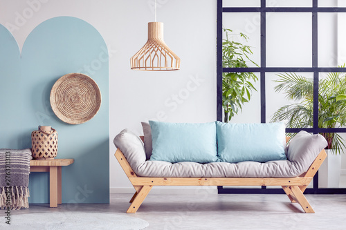 Poster Individuel Urban jungle in bright white and blue living room interior with scandinavian futon sofa