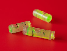 Green Bubble Level On Red Background